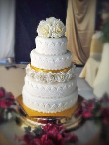 Wedding Cakes Middlesbrough 4-Tier-White-Wedding-Cake-with-Yellow-Roses
